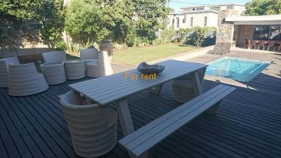 2 Outside entertainment areas with build in braai and climpse of sea view.